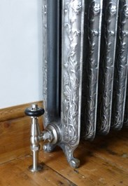 This image shows an example of a satin nickel sleeve kit on our office hand burnished Daisy radiator