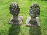 An excellent pair of A pair of Weathered Stone Gate Pier Pineapple Finials