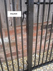 showing the wrought iron gate centre drop bolt