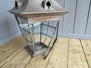 Showing the hinged front glass to allow access to the antique lantern