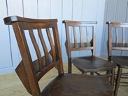 Showing the curved slatted back rest of the church chairs