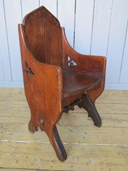 Showing the side detailing of the gothic tub chair