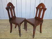The mahogany gothic hall chairs have a lovely patina to them from years of use