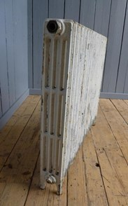 Showing the side of the reclaimed cast iron radiator - 4 Columns Deep x 18 Sections Long
