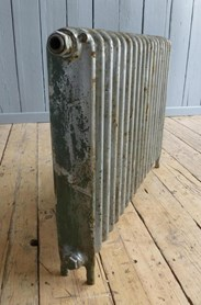Showing the side of the reclaimed cast iron radiator - 1 column and 18 sections long