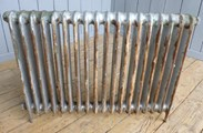 Showing the other side of the cast iron radiator - 1 column and 18 sections long