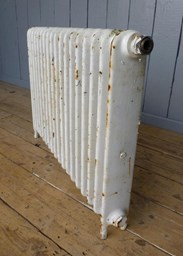 Showing the side of the cast iron radiator - 1 column x 18 sections long