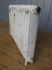 Showing the side of the cast iron radiator - Reclaimed from Barnsby Saddlery - 1 Column x 18 Sections Long