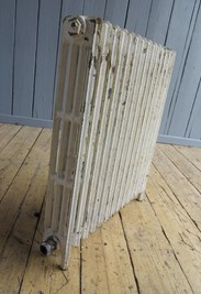 Showing the side of the reclaimed cast iron radiator - 4 columns deep and 14 sections long