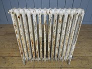Showing the other side of the reclaimed cast iron radiators - 4 columns deep and 14 sections long