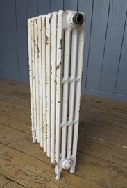 Showing the side of the reclaimed cast iron radiator - 4 columns deep and 8 sections long