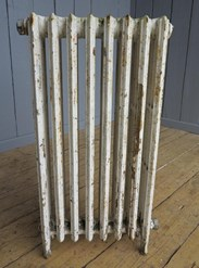 Showing the other side of the reclaimed cast iron radiator - 4 columns deep and 8 sections long