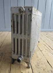 Showing one end of the reclaimed cast iron radiator - 6 columns deep x 17 sections long