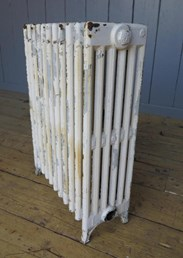 Showing an end of the reclaimed cast iron radiator - 6 columns deep and 11 sections long