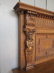 Showing the beautiful hand carved detailings of the victorian oak fire surround