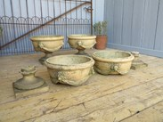 Showing the Victorian terracotta planters seperated into their bowls and pedestals