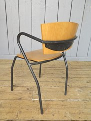 Showing the back of the vintage tubular stacking chairs