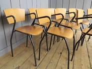 Side of the vintage tubular steel stacking chairs