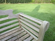 Showing the lovely construction of the arm of the vintage lutyens teak garden bench