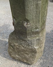 Showing the base of the antique stone posts that would sit into the ground