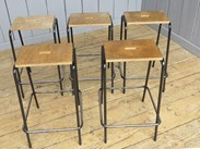 Side view of the tubular steel stacking stools