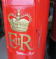 Close up of traditional gold hand painted letters and crown of ER II Pillar Box