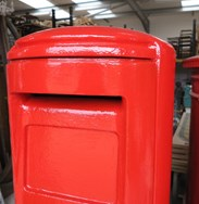 Showing the mail slot of the cast iron original ER II pillar box