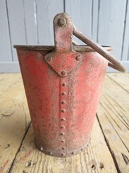 Showing the rivets and handle of the antique fire water bucket