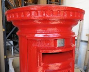 Showing the Sunday collection plate on the royal mail cast iron pillar box