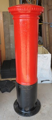 Side view of the royal mail pillar box in our warehouse