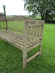 Side view of the vintage teak garden bench