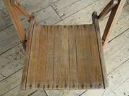 Close up of the slatted seat of the antique folding chairs