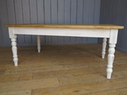 Showing the distressed base of the reclaimed plank top Farmhouse table
