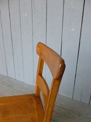 Close up of the back of the solid oak antique dining chairs