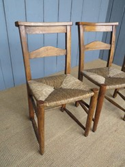 Showing the antique rush seated kitchen chairs