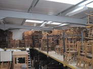 Showing more of our stock of antique church chairs in our dry warehouse