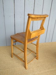 Showing the book holder on the rear of the church chair