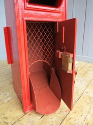 Showing the internal cage and mail shoot of the cast iron GR post box