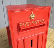 Showing the gold lettering of the Post Office and Crown of the GR post box