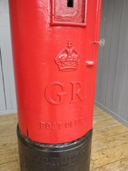 Close up of the main body of the original cast iron george pillar box