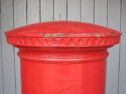 Showing the top of the Original Cast Iron George Pillar Box