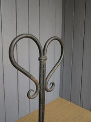 Close up of the wrought iron rolled boot scraper handle