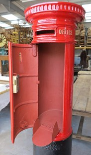 Showing inside of the Edward 7th pillar box with chubb lock and mail shoot