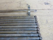 These solid brass stair rods are in their original reclaimed condition
