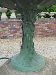 Showing the base of the bronze vintage fountain on the stone base