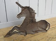 Showing the back of the Victorian Cast Iron Unicorn Doorstop