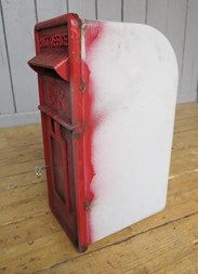 Showing the side of the royal mail post box arch back for restoration