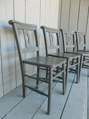 Side view of some hand painted distressed church chairs