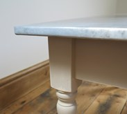 The table base is Farrow and Ball London Stone and then lightly distressed<br>The primer/undercoat and the bare wood are showing through sligthly as we have distressed it