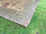 Showing the lovely weathering of this antique york stone table top